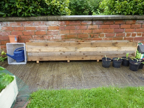 Recycled pallet struts created a planter box