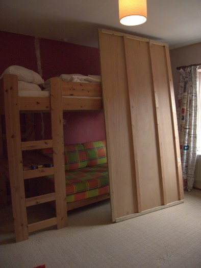 One side of the wardrobe down! The plywood has already been earmarked for other projects - waste not want not!