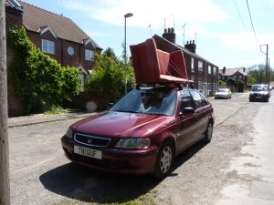 It was bad enough fitting the roof bars to my Dad's dearly beloved pride and joy, Honda Civic, but to then add insult to injury by loading a second-hand sofa onto it beggars belief.