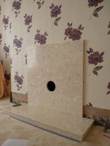 Step 3 - centre the insert and drill holes for retaining screws. Easier said than done as this particular chimney breast seems to be made with pre-stressed concrete - well let's put it this way we were all quite stressed by the time Chris had 'hammered' through to Ripon.