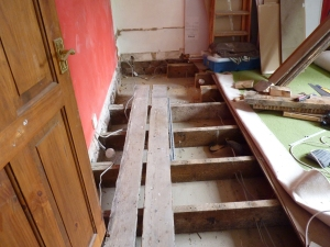 It wasn't long before Chris was really motoring along and soon all floor boards were up and several joists cut to reveal the new space for our staircase - exciting and scary!