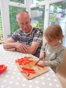 Grandad training up the youngest grandchild - obviously for the processing of all the produce, as can be seen from above!