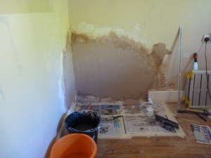 Damp discovered and treated. Chris then plastered the walls ready for the stairs to be finally put in place.