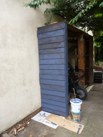Designed and painted the new woodstore. Also re-painted the fences ready for winter.