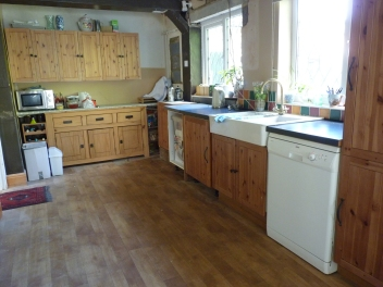 The removal of the door seems to have made the kitchen look bigger. It has certainly allowed us more work surface!