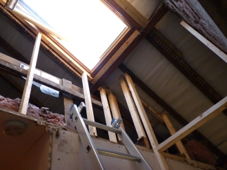 Chris had to work out where to position the studwork in order to insulate and plasterboard the walls and roof surrounding the skylight - not as much fun as you might think!