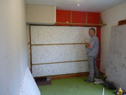 Chris put battens on the wall for a layer of insulation as well as for the tongue and grooved cladding that is going on this wall.