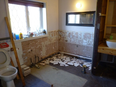 Tiles off ready for the new bath to be located - oh well things always look worse before they get better.