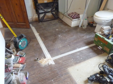 You've heard of X marks the spot, well, this is L marks the spot where the new stud wall will go in order to create the new en-suite area!