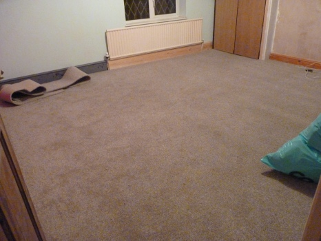 Our bedroom with the new carpet laid - now to put the furniture back ... but first off to B&Q to buy a couple of louvre doors (Wednesday - OAP discount day!).