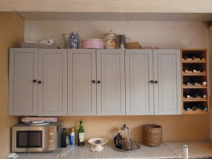 Stage 1 - unsightly mess on top of the kitchen cabinets.