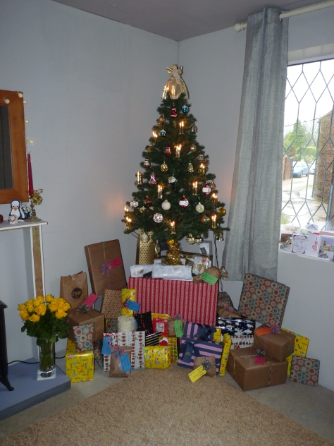 After stockings and breakfast all presents put around the tree.