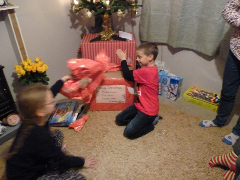 Finally, the last box to be opened on Boxing Day after a jolly walk to the park was the biggest box of all, full of presents for Madeleine, Matthew and Daisy - all tied up with a great big bow! Merry Christmas everyone and a Happy New Year.